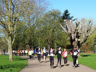 Many runners in the park