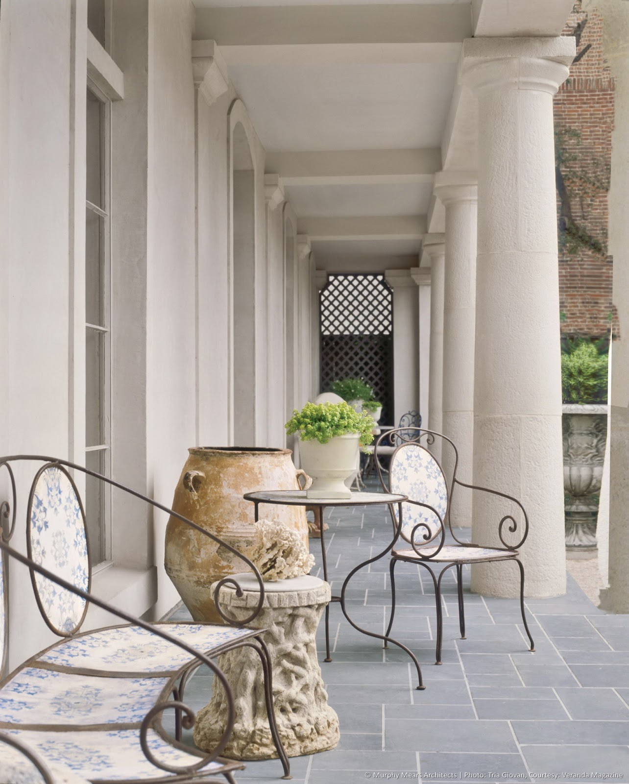 Beautiful stone patio at French inspired home in Houston Murphy Mears