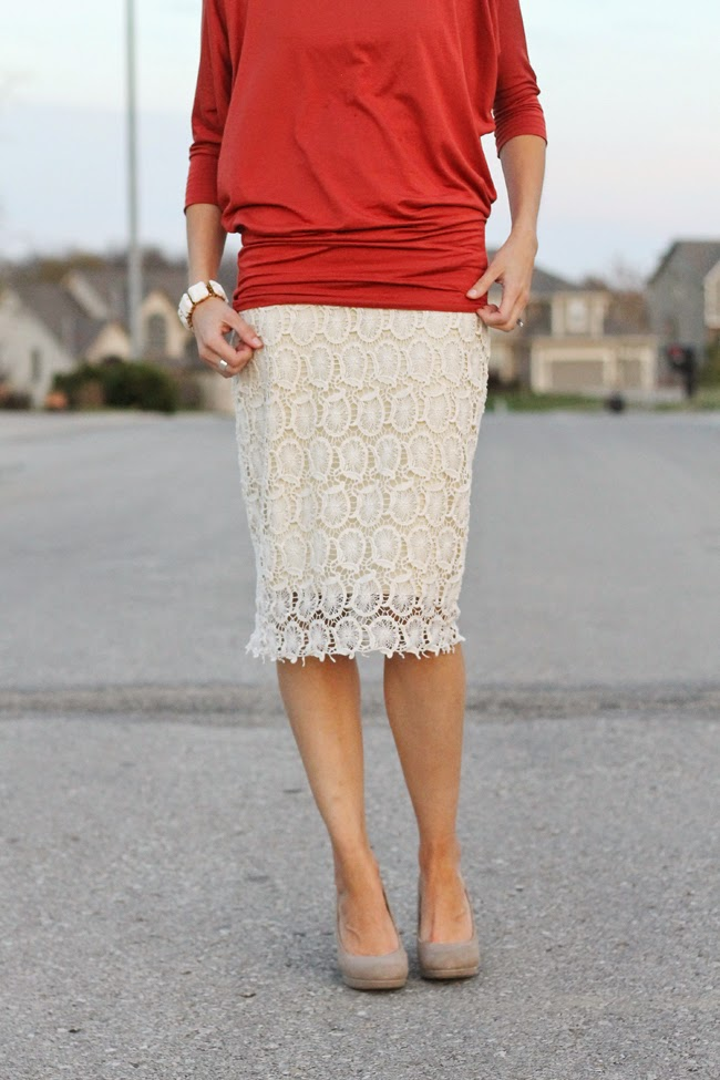 Burnt orange blouse and cream lace skirt with nude heels