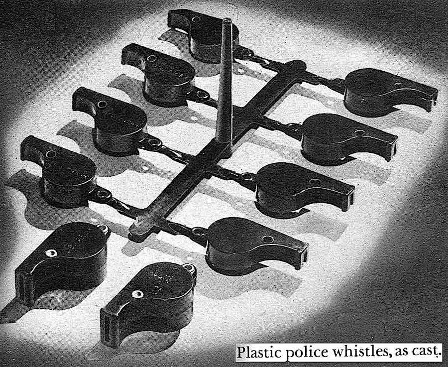 """a 1944 pohotograph """"Plastic police whistles, as cast"""""""