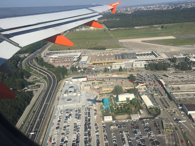 view from the air of path to new T2 train station of Milan Malpensa Terminal 2