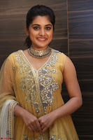 Nivetha Thamos in bright yellow dress at Ninnu Kori pre release function ~  Exclusive (86).JPG
