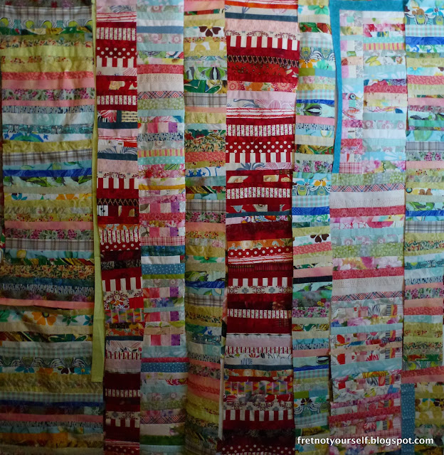 Inserting fabric into Improv string quilt, Chinese Coins