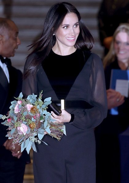 Meghan Markle wore Givenchy velvet Appliquéd midi dress, Birks snowflake snowstorm diamond earrings, Aquazzura Deneuve pumps, carries Givenchy clutch