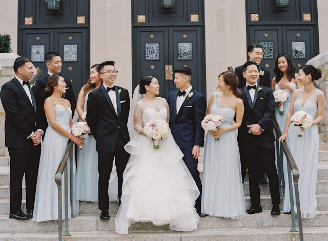 The bride, groom, and bridal party in front of the church in Island Park NY