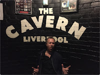 Man on a stag do by The Cavern Club Liverpool sign