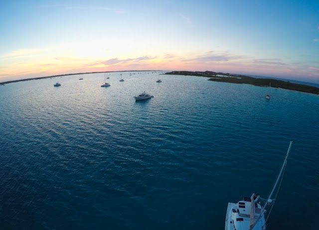 Drone shot: Sailboats at anchor at sunset, George Town Exumas