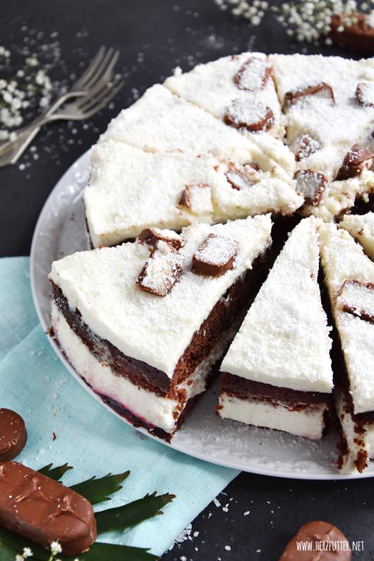 Verschneite Himbeer-Kokos-Schoko-Torte