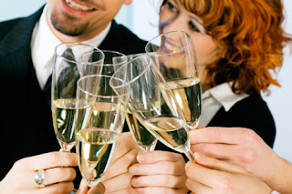 Photo of a couple toasting with champagne for New Year's