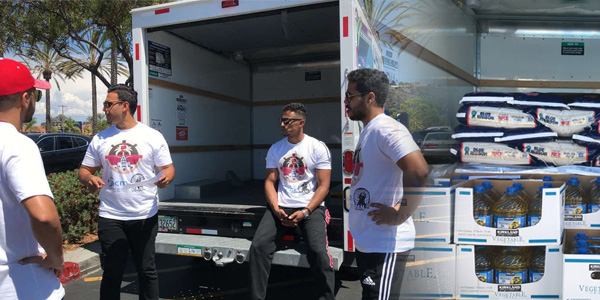 Abdullah Jadallah and club members donating supplies to refugees.