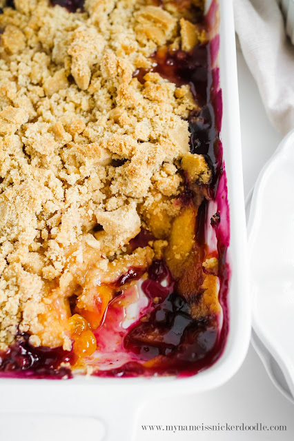 Use simple ingredients along with fresh peaches and blueberries to make this awesome and easy crisp recipe!  Perfect for a summer party!  |  mynameissnickerdoodle.com