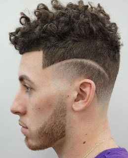 Curly hairs with side fade and shave line