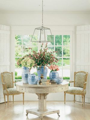 Shannon Bowers round table antique chairs blue and white urns