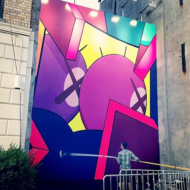 Street Art Mural By KAWS in Brooklyn, New York City. work in progress