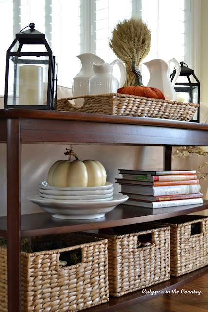 Fall console table with pumpkins and baskets