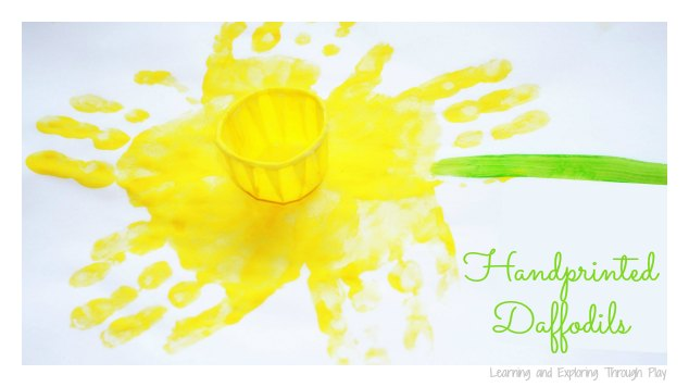 Daffodil painting done with yellow paint, hand prints, and small paper medicine cups.