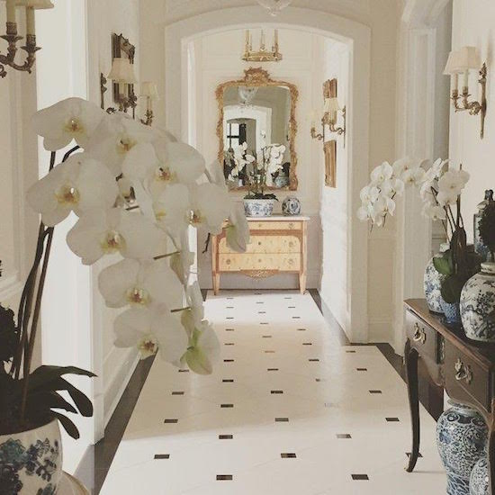 Gorgeous Paris inspired black and white hallway with marble stone floor and orchids by Enchanted Home