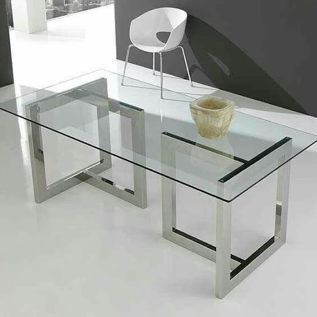 A table with a glass top is modern and stylish
