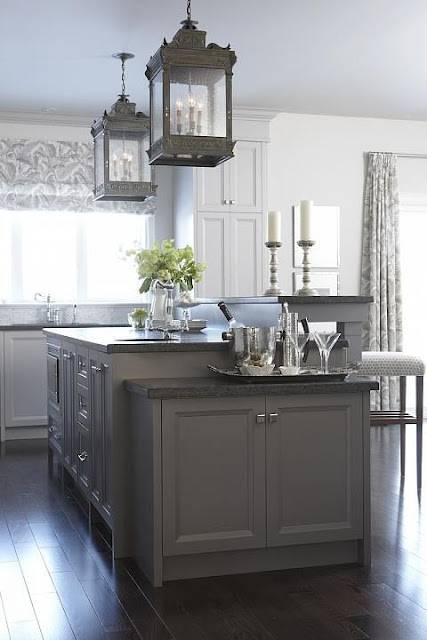 Farmhouse kitchen by Sarah Richardson with large lanterns over island