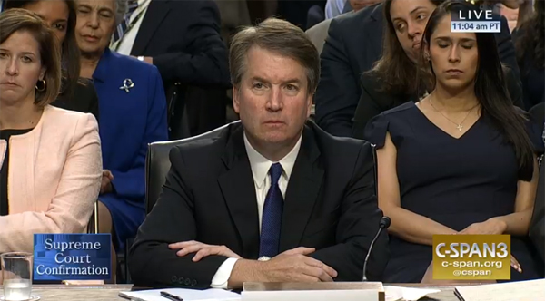 image of Brett Kavanaugh sitting stone-faced during his nomination hearing on its first day