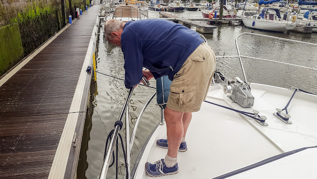 Photo of Phil fitting one of the new rod holders