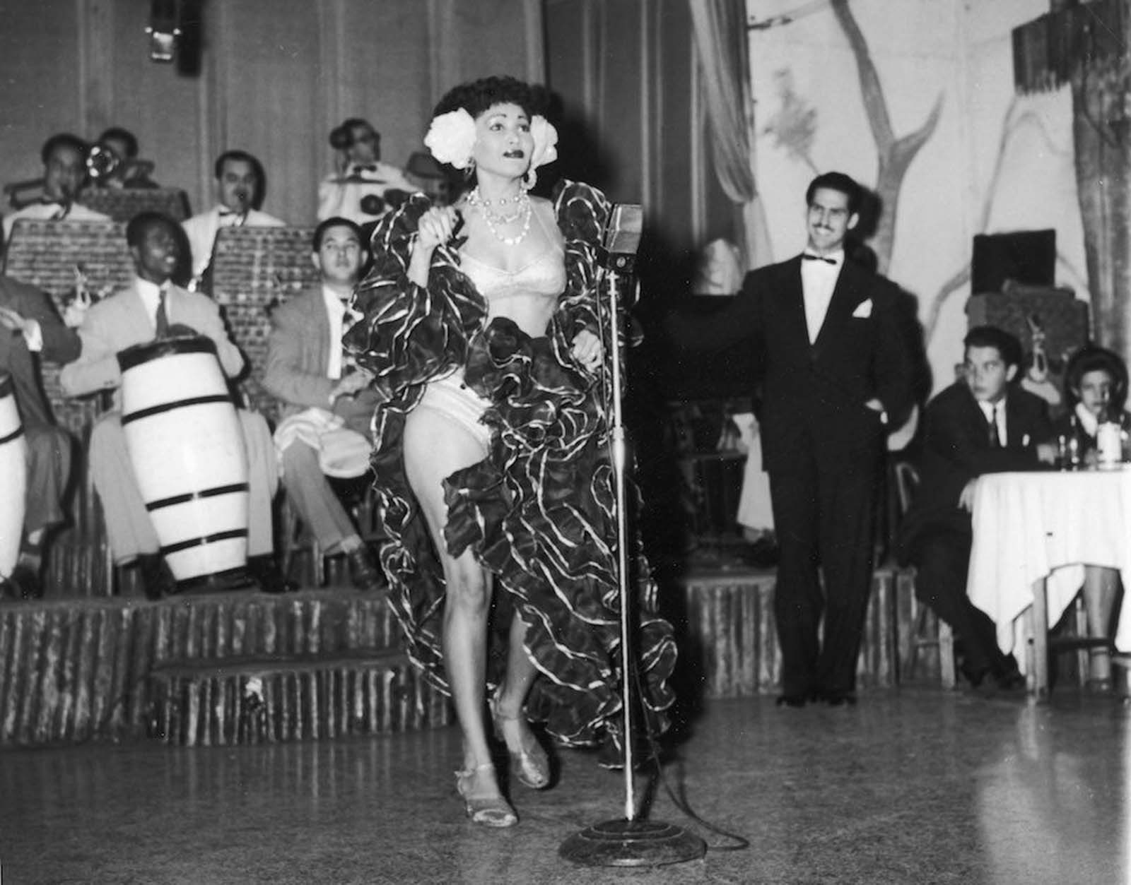 A Cuban rhumba dancer named Zulema performs on stage with a band at the Zombie Club on Zulueta Street in Havana. 1946.