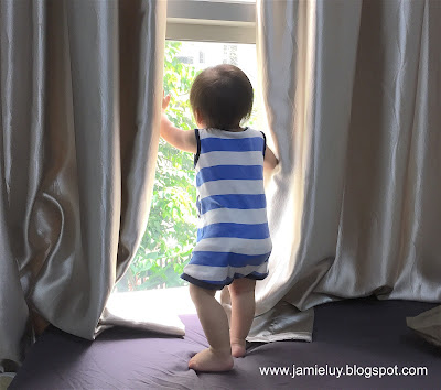 Baby by the window wearing carter's