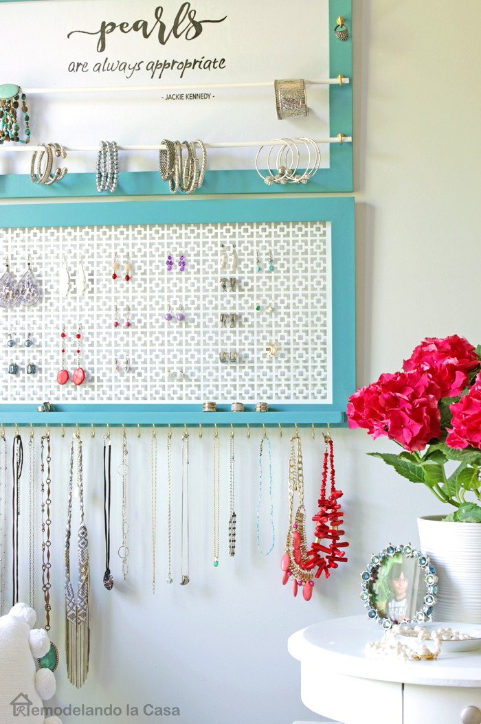 Jewelry organizer in bedroom with pink hydrangeas