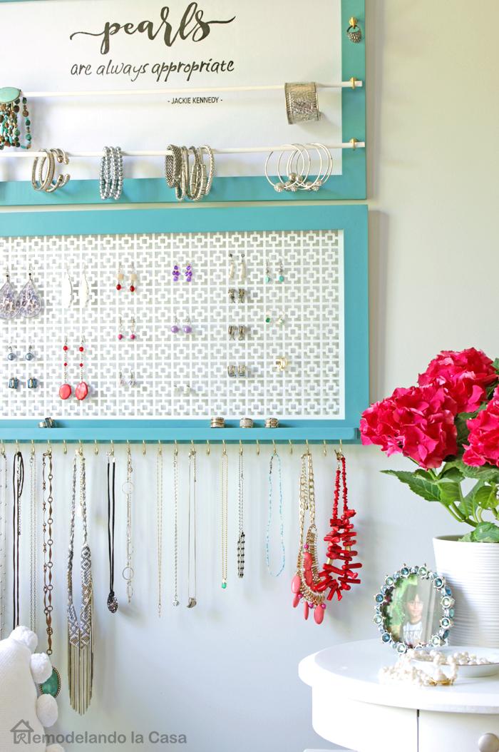Jewelry organizer in bedroom with pink hydrangeas