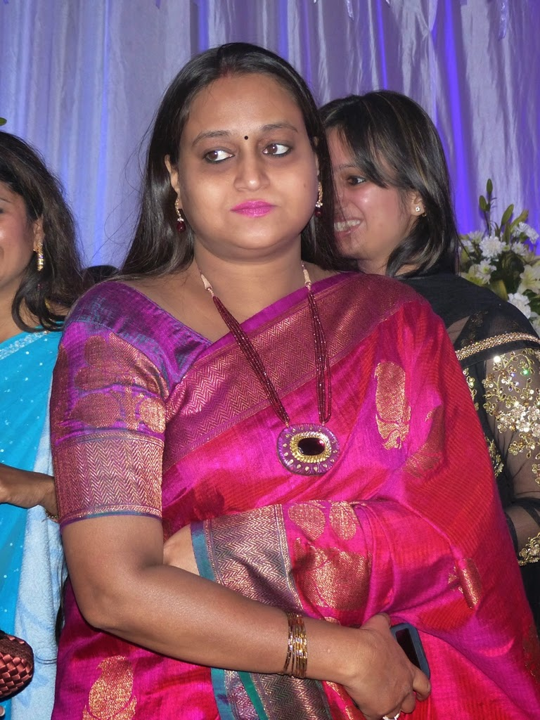 Indian woman in sari wearing beautiful necklace