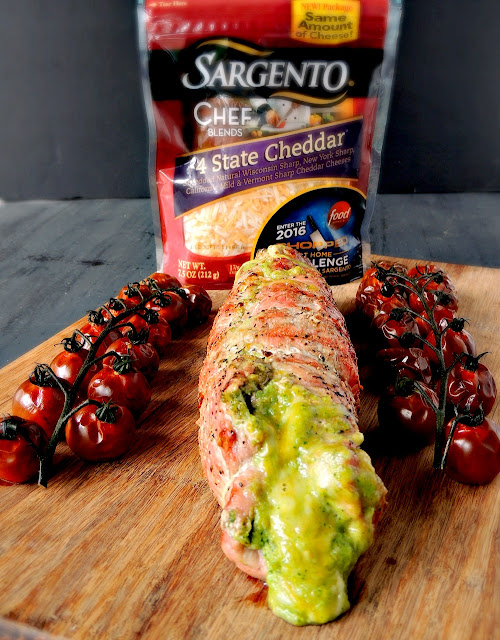 Broccoli Pesto and Cheese Stuffed Grilled Pork Tenderloin - Delicious, cheesy, melt in your mouth pork tenderloin, with amazing smoky grill roasted cherry tomatoes on the side. From www.bobbiskozykitchen.com