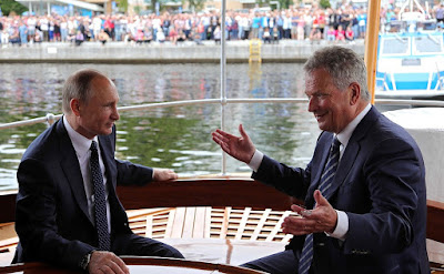 Vladimir Putin with President of Finland Sauli Niinisto aboard the steamboat S/S Saimaa.