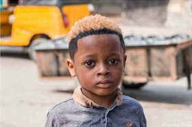 Olamide Shares Photo Of A Boy Rocking His Kind Of Hairstyle