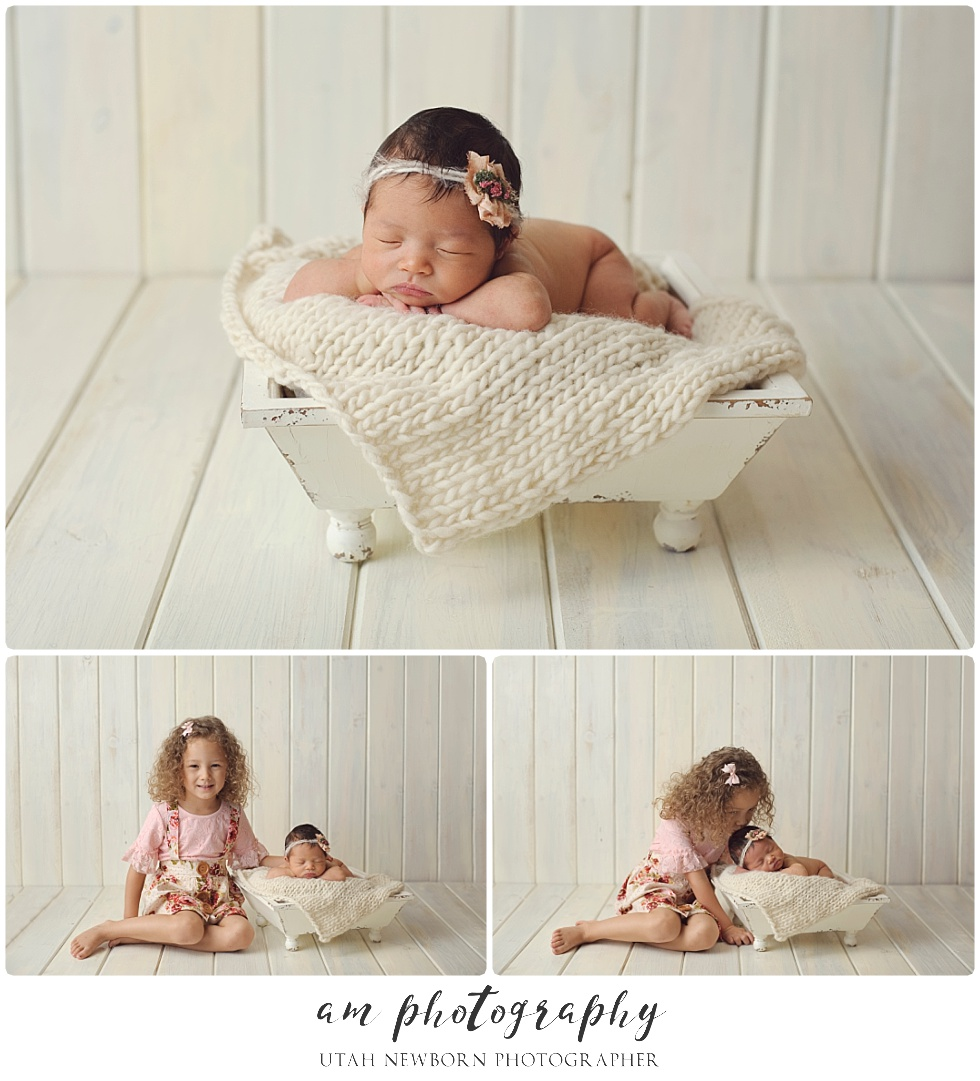 salt lake newborn photographed with big sister giving kisses