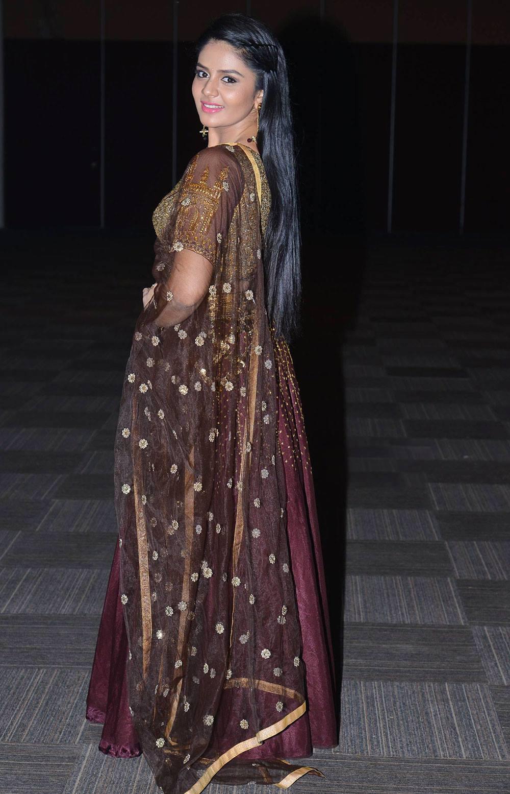 Tv Anchor Sreemukhi Long Hair In Maroon Half Saree