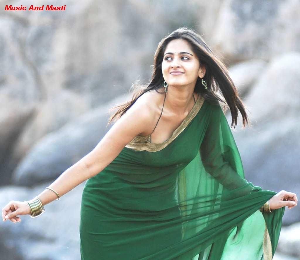 Music And Masti: Anushka In Green Saree Strip...Sleeveless Top
