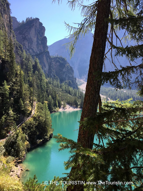 Hiking path with a view at Lago di Braies in the UNESCO nature heritage listed Prags Dolomites