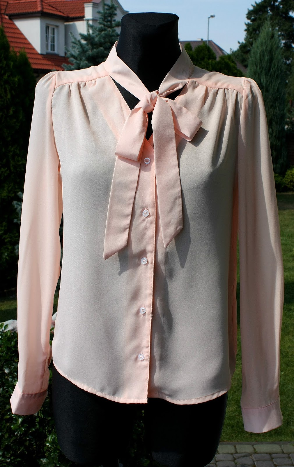http://www.dresslily.com/bow-tie-collar-long-sleeve-solid-color-blouse-for-women-product1388338.html?lkid=1505435