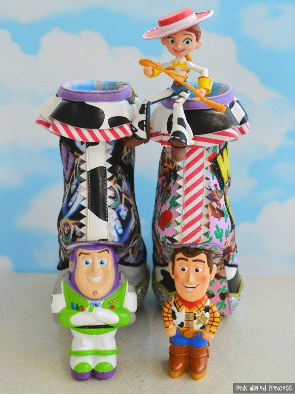 Disney Toy Story ankle boots shown from behind with Buzz and Woody heels and small Jessie doll sitting on top
