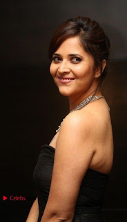 Telugu Anchor Actress Anasuya Bharadwa Stills in Strap Less Black Long Dress at Winner Pre Release Function  0025.jpg