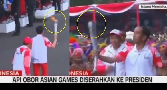 Ini Video Saat Api Obor Asian Games Tiba-tiba Padam di Tangan Jokowi