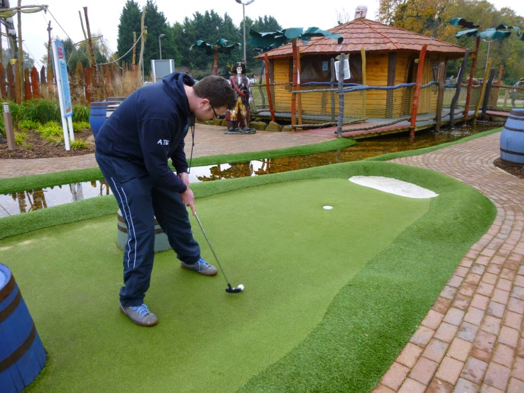 Oliver Florence putting during the Surrey Invitational Tournament round at Pirate Island Adventure Golf at Hoebridge Golf Centre in Woking
