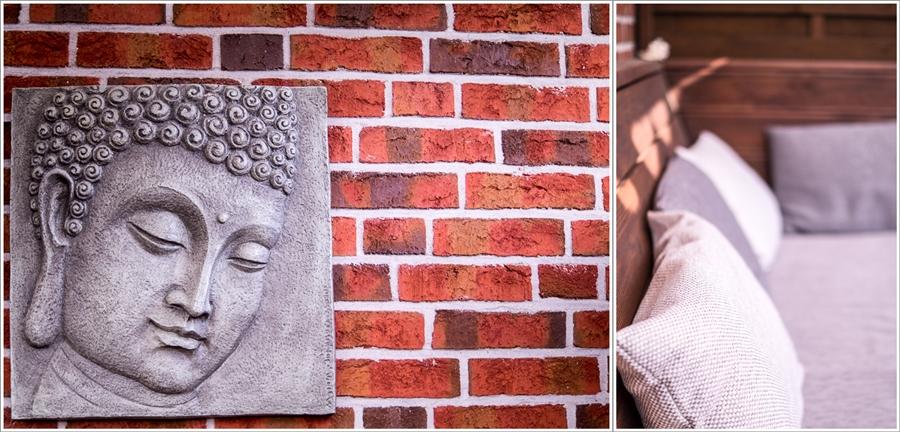 Blog + Fotografie by it's me | fim.works | Ein Garten im Norden | Collage von Buddha-Bild aus Beton und Kissen in einer Lounge