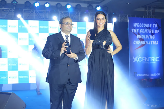 Priyanka Communications MD, Manish Agarwal with Bollywood actor Neha Dhupia at the CENTRiC Smartphone launch(1)