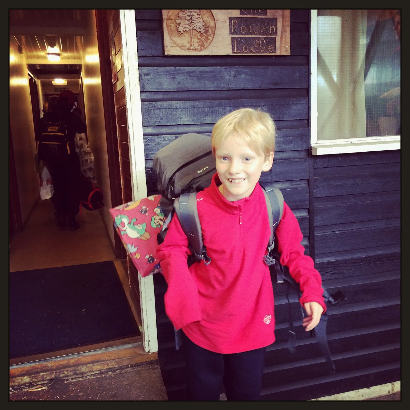 child at camp with rucksack