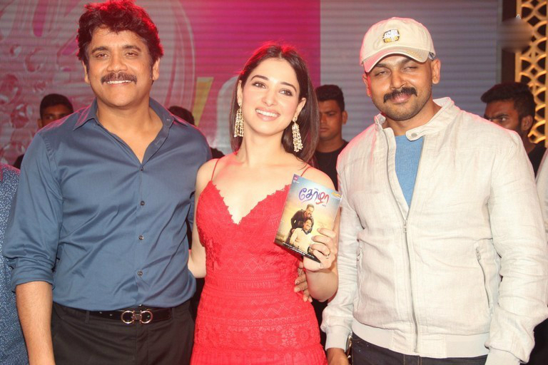 Tamanna flaunts Nagarjuna and Karthi at Thozha Audio launch. Hot Tamanna in Thozha, Hot Tamanna in Oopiri, Red dress, Nagarjuna and Tamanna, Hot Tamanna in Thozha-Oopiri audio Launch. hot and sensual Tamanna in Thozha, hot and Sensual tamanna in OOpiri