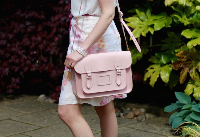 Fake Fabulous | Feminine pink and girly, A-line button through skirt, lace shoulder top, pink Cambridge satchel company bag, french sole ballerinas.
