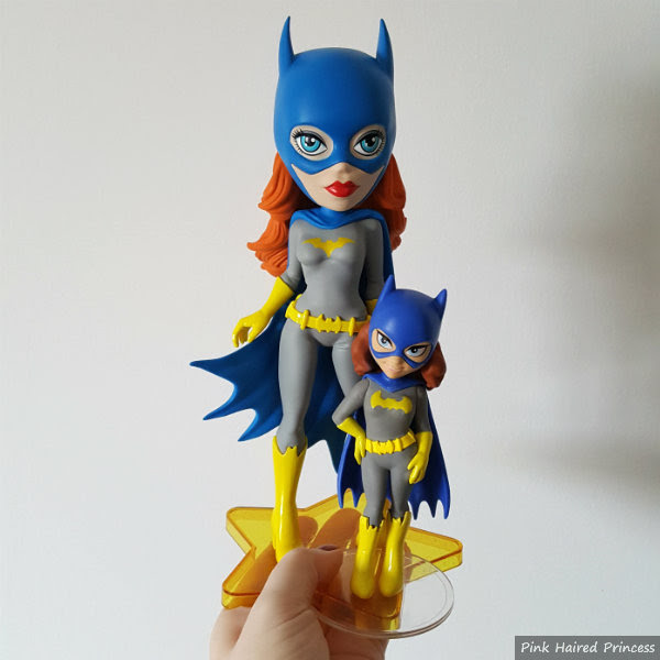 height comparison of funko vinyl vixen and rock candy batgirl figures