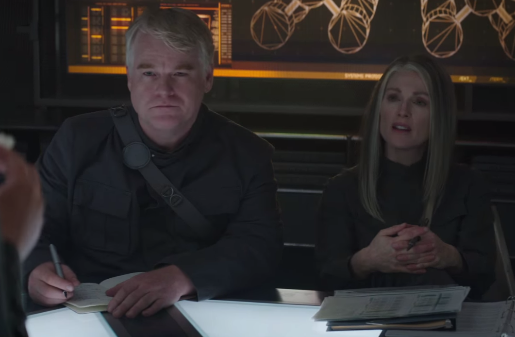 Reaction to Katniss' demands by Plutarch and President Coin - Mockingjay Part 1