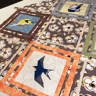 Table topper quilt made from bird quilt blocks